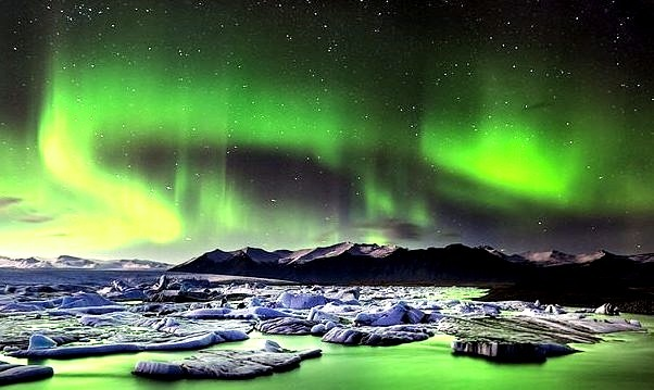 by Iceland Aurora on Flickr.Aurora Borealis and a beautiful lagoon in the south-eastern part of Iceland.